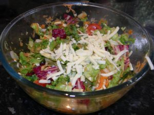 Homemade mixed salad served in a large bowl