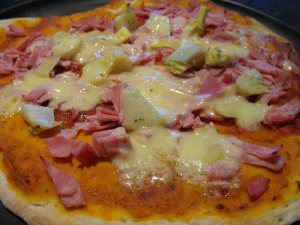 pizza with artichokes, ham and cheese