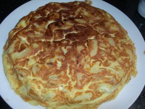 potato onion omelette serve in a large plate