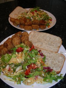 salad served with chicken balls
