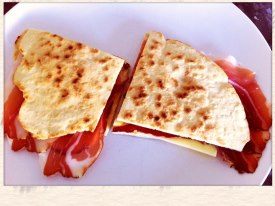 piadina served with speck and cheese