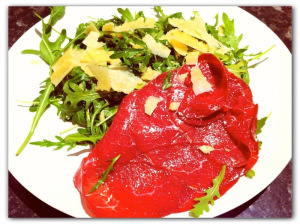 bresaola and rocket salad on a plate