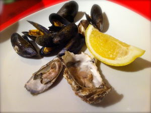 oysters and mussels served with lemon slice
