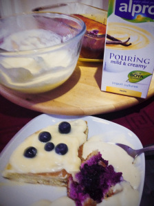 pouring mild and creamy yogurt as side for blackberries flaugnarde