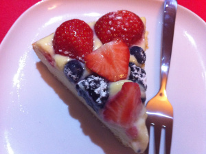 a slice of tart of strawberry and blueberry tart