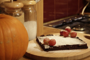 serve the chocolate cake with red grapes