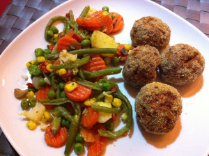 serving meat balls with veg