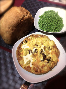 omelette served with peas and bread
