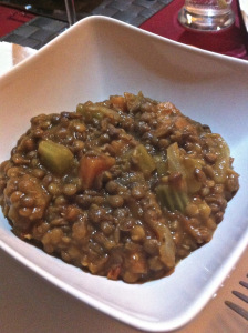 Lentils served warm lovely with some parmesan on the top