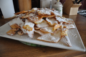 chiacchiere di carnevale with icing sugar