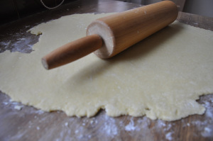 roll the sweet pastry for chiacchiere di carnevale