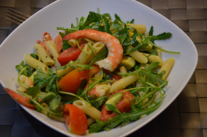 prawn and avocado pasta salad served in a bowl