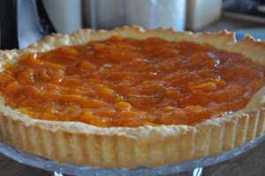 Apricot tart is on serving plate