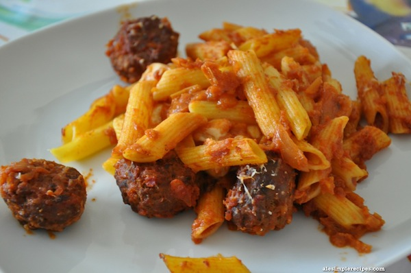 Baked pasta with meatballs and mini mozzarella cheese