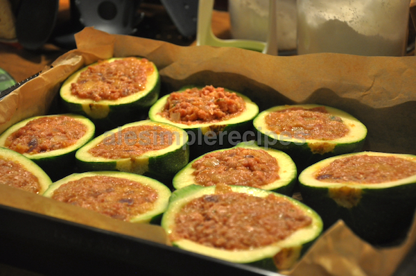 Stuffed zucchini with minced beef ready to bake