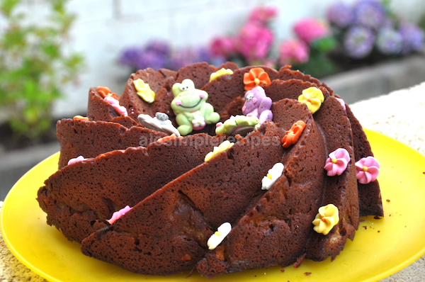 chocolate and pear cake decorated with sugar flowers and animals