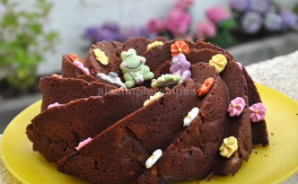 Chocolate and pear cake decorated with sugar flowers and cute animals