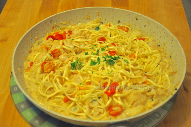 Add linguine to the pan with white fish in bed of lemon cream
